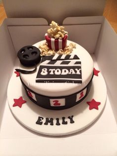 Film themed cake with popcorn, film reel and clapper board #yummilciouscakes