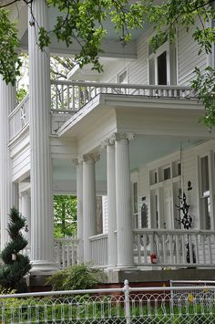 Large columns, sweeping front porches, and balconies are typical of the Southern plantation home's design