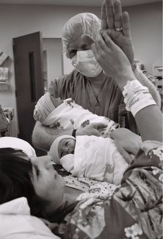 Dad giving mom a High 5 after a natural hospital birth of TWINS!