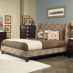 Add some elegance to your bedroom with this spectacular mahogany California king size bed. Covered in luxurious cream- and coffee-colored padded upholstery, this extremely durable shelter bed comes with all hardware and is easy to assemble.