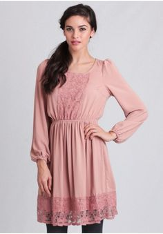 <div><p>Crafted in a beautiful light pink hue, this feminine dress features pink lace paneling at the bodice and hem and is complete with an elastic waistband for the perfect fit. Finished with a back keyhole cutout with button closure and elastic cuffs at the sleeves, this adorable dress pairs well with tights and ankle boots for a chic fall ensemble.</p><p>100% Polyester<br /> Imported<br /> 30
