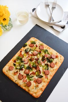 Goat cheese makes the best pizza topping! It pairs perfectly with the sausage, bacon and Brussels Sprouts! This is a great, fast weeknight meal idea.