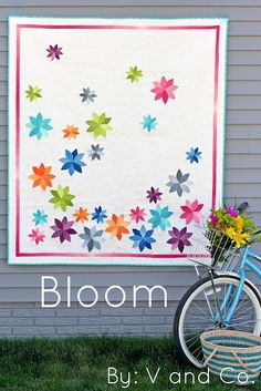 Bloom, a new quilt pattern from V and Co. It is available as a pdf or a paper pattern. It is made with the ombre jelly roll she designed for Moda.    I just love every single thing about this quilt!