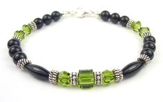 http://www.sobrietystones.com/02-black-birthstone-bracelets/B8808a-BLKOX-olivine-black-birthstone-bracelet.jpg