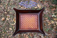 This Valet tray was made here at my shop in Oklahoma. Its hand tooled from the finest American made leather available and finished with an antique sunburst stain.