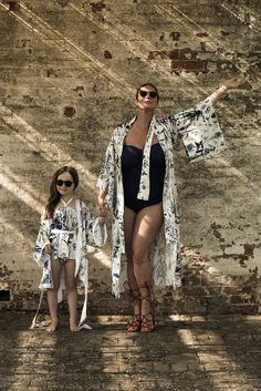 Lisa & Bobby in matching silk, printed robes. Bobby wearing a matching silk halterneck playsuit. #hermionedepaula #lisamcallister #motherdaughter #kimonorobe #beachwear #swimwear #childrenswear #matchingrobes Bridal Wedding Dresses, Bridesmaid Dresses, Beachwear, Swimwear, Bridal Lingerie, Hermione, Playsuit, Mother Of The Bride, Dress Outfits
