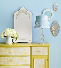Once you've picked your wallpaper you can begin your dresser makeover. Rejuvenate the drawer fronts of this tired dresser with Floral wallpaper and a corresponding layer or two of paint