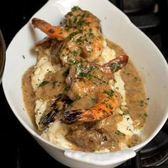 Ultimate Shrimp and Grits -- milk, heavy cream, stone-ground white cornmeal, butter, salt and pepper, evoo, onion, garlic, andouille sausage, flour, chicken broth, bay leaf, shrimp cayenne, hot sauce, parsley, chives.   Serve on top of biscuits.