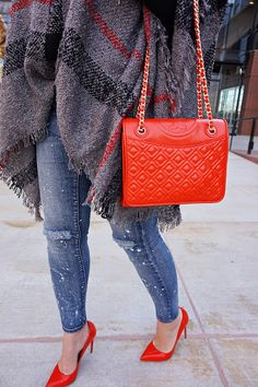 red pumps, red tory burch bag, ripped knee jeans, cape, Karen walker super duper sunglasses, poncho, preppy style, hair bow, street style, turtleneck pincho