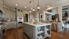Imagine hosting a #party and #cooking #dinner in your #gourmet #kitchen with tons of #cabinet #space and a huge #kitchen #island in the center. #dreamkitchen #pastel #colorscheme