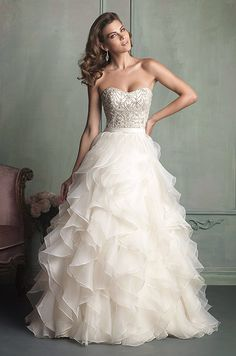Pretty beaded top and ruffled skirt! Allure, 2014 love the top but am not sure this is too much for an outdoor wedding