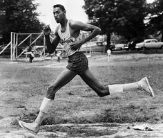 Wilt Chamberlain running high school track -- Look at those longgggg legendary legs and the stride lengths.