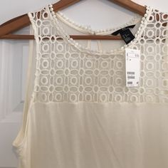 H&M Eyelet Top NWT Beautiful H&M top with eyelet detail. NET from last summer. Soft 100% Viscose. Size M. H&M Tops