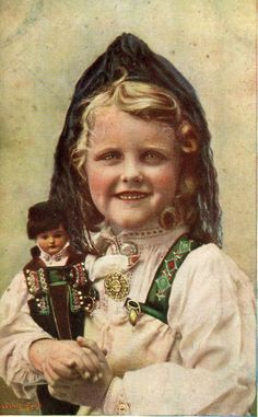 Antique photo of a Norwegian girl and her doll, in traditional costumes called bunad.