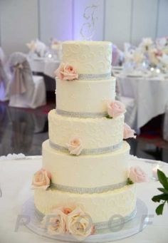 This is really, Really pretty!  I think I just might love this cake!  Fairly simple, but with lovely details... ahhhh yup, I think something like this might have to be our wedding cake.  Made of cheesecake, of course :-) ~ Lacey pink and gray wedding cake