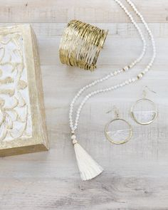 Trades of Hope - Spring 2017 Gift Set This gift set includes the Harper Necklace from Thailand, the Warrior Cuff from India, and the NEW capiz Grace Earrings from the Philippines, all carried in a beautiful golden and white-washed wooden box. With every purchase of this gift set, a baby blanket with be gifted to babies around the world in order to maintain and improve health.