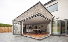 This system is designed for where you have two bifold doors meeting at a corner, the corner post then sweeps away as the doors open. Corner Bifold Doors, Bifold Doors Extension, Corner Door, Roof Extension, Kitchen Bifold Doors, Conservatory Extension, Extension Plans, Corner Wall, Garden Room Extensions