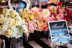 Ombre floral centerpiece with black and white striped linen