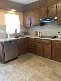 a challenge with updating an outdated kitchen using, paint, new hardware, modern accessories, to create a budget kitchen makeover. Kitchen Cabinets And Cupboards, Painting Kitchen Cabinets, Kitchen Paint, Kitchen Redo, Home Decor Kitchen, Kitchen Ideas, 1970s Kitchen Remodel, Budget Kitchen Remodel, Kitchen On A Budget