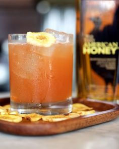 This Sea Monkey Cocktail made with Wild Turkey American Honey is great for any afternoon - 4 Batch Cocktails That Will Make Your Summer | Thrillist