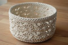 This is an item from my Parcel String Ensemble although technically its not made from parcel string but from a chunky cotton craft string, cream coloured with a lovely lace pattern.  Diameter:15.5 cm, height 9 cm (Diameter: 6.1 inches, height: 3.5 inches)  It is ideal for storage - anything from your current crochet or knitting project, ribbons, yarns, other craft accessories, to playing cards, small puzzles etc.- and helps you organise and decorate at the same time.  Also perfect as a…