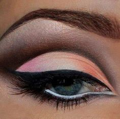 cut crease peach and grey smokey eye with winged eyeliner and white waterline
