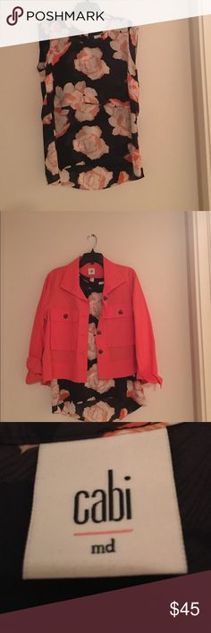 Floral cabi top Navy with oversized flowers with orange. Pink and magenta colored trim. Tiered layers make it drape and flatter. Cap sleeve offers just a bit of coverage. Coordinating jacket available. Bundle for discount. CAbi Tops Blouses