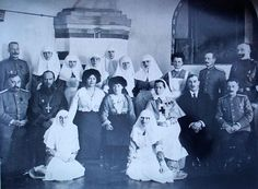 Marie and Anastasia at their hospital with A.Vassiliev the priest.