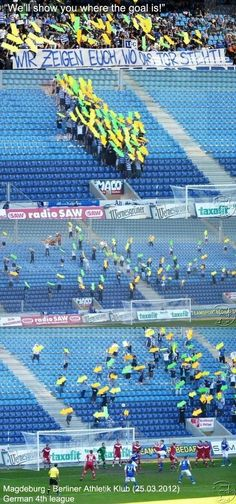 """Ha ha! German fans tired of their team not scoring help them out. The sign reads """"We'll show you where the goal is!"""""""