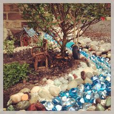 Fairy garden water feature with blue and clear stones!
