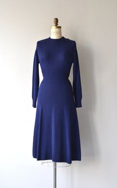 Vintage deep blue St. John knit dress with long sleeves, bishop cuffs, contoured bodice and back zipper. --- M E A S U R E M E N T S ---  fits like: