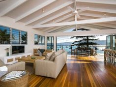Beach House Tour in Paradise ...like triangle roof and exposed beams. Would prefer them in natural wood colour!