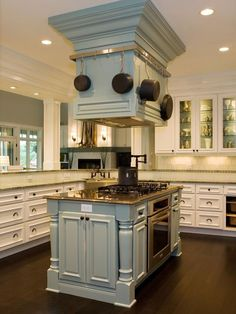 love this color!!! Custom Designed Stove Hood Doubles as Pot Rack