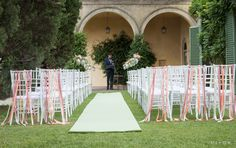 wedding ceremony in tuscany, blessing n the garden . Floral decoration with hanging jars of flowers and ribbon on chairs Flowers by Jardin Divers www.jardindivers.it @jardindivers wedding, tuscany wedding, wedding inspiration, real wedding, wedding in florence, italian wedding, wedding in italy