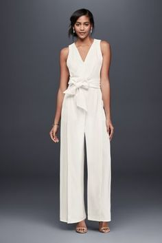 The jumpsuit has surpassed trend status to become a fashion staple. This drapey crepe version, featuring a surplice bodice and easy wide legs, is an effortless choice for a bridal shower, rehearsal dinner, or even the ceremony itself.   By Keepsake  Polyester  Back zipper; fully lined  Machine wash  Imported