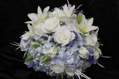 blue and white bouquet with wedding flowers like muscari, lavender, tulips, and lilies, Dallas wedding flowers
