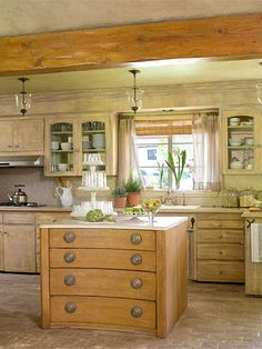Mirrors in backs of cabinets, dressers used as an island, brick floor, wood beam...