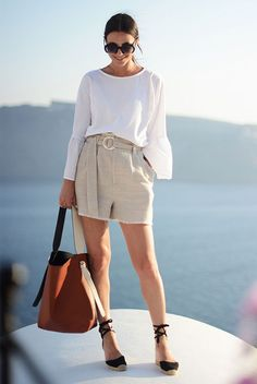 summer outfit, casual outfit, beach outfit, summer getaway outfit, summer travel outfit, summer vacation outfit - white ruffle sleeve top, beige belted shorts, black espadrille wedges, black round sunglasses, brown bucket bag Espadrilles Outfit, Wedges Outfit, Black Espadrilles Wedges, Mode Outfits, Short Outfits, Casual Outfits, Short Dresses, Fast Fashion, Look Fashion