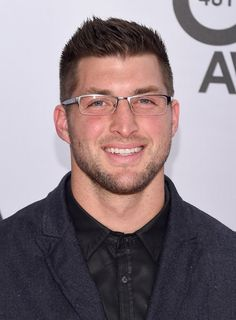 Tim Tebow Photos - Arrivals at the 48th Annual CMA Awards - Zimbio
