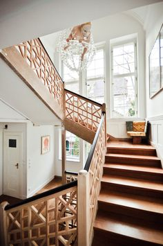 Chippendale-style stair rail and a funny monkey hanging from the chandelier! - home of gallerist and art collector Thomas Andrae, Berlin