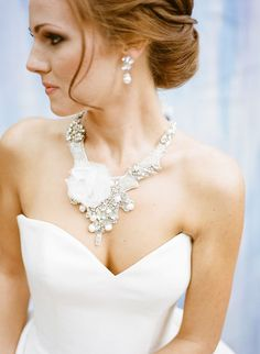 A strapless gown is fun and easy to accessorize because you can pair just about anything with it! Bold, multi-strand necklaces, bejeweled bibs, and even classic pearls pair nicely with this dress shape. See more: http://theeverylastdetail.com/how-to-choose-wedding-jewelry/