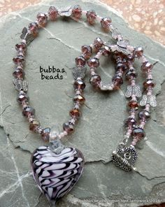 Glass heart with crystal and butterfly bead necklace. www.facebook.com/bubbasbeads