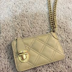Marc Jacobs leather wristlet Selling a Marc Jacobs quilted leather small wristlet (ideal for $ & keys) with gold chain. This item has been gently worn. Marc Jacobs Bags Clutches & Wristlets