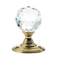 Facetted Clear Glass Ball Door Knobs on Polished Brass Roses - The Facetted Clear Glass Ball Door Knob is an excellent addition to any door. The polished brass finish will add a traditional look to any room. This knob is also available in a variety of coloured glass and roses