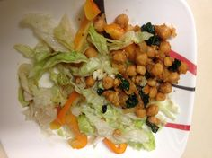 Chick peas salad: fried chick peas on a bed of iceberg lettuce and orange peppers.