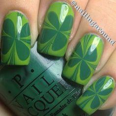 Water marbled four leaf clover.Polishes used were both#opi - #jadeisthenewblack & #whotheshrekareyou.  @nailingaround
