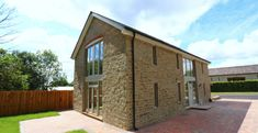Lightweight natural stone cladding slips cut from our premium sandstone. Create the effect of a true random stone wall, in a fraction of the time and cost. Stone Cladding Exterior, Natural Stone Cladding, Natural Stone Wall, Natural Stones, Building Stone, Building A House, Rockery Stones, Tonne, Stone Houses