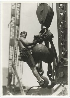 A worker riding on a crane hook,   PHOTOGRAPHS OF THE EMPIRE STATE BUILDING UNDER CONSTRUCTION.  Lewis W. Hine