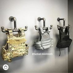 Tactical Vest Hangers - Real Time - Diet, Exercise, Fitness, Finance You for Healthy articles ideas Tactical Wall, Tactical Vest, Police Tactical Gear, Tactical Guns, Airsoft Gear, Weapon Storage, Gun Storage, Police Gear Stand, Gun Safe Room