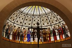 http://www.fosterstainedglass.com/images/full/mdp_01.jpg  St Martin De Porres Church, Lake Charles. Foster Stained Glass. Stunningly beautiful witness of saints above the main altar.